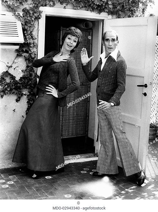 Italian singer, actress and showgirl Caterina Valente and dancer and choreographer Don Lurio (Donald Benjamin Lurio) posing before an open door