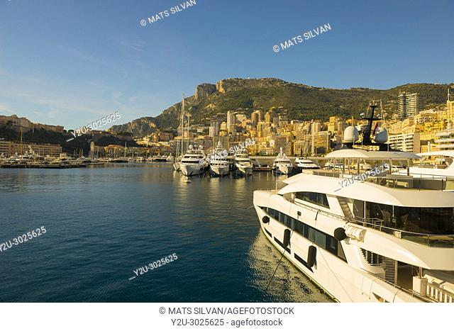 Port with Luxury Yachts and Cityscape over Monte Carlo in a Sunny Day in Provence-Alpes-Côte d'Azur, Monaco