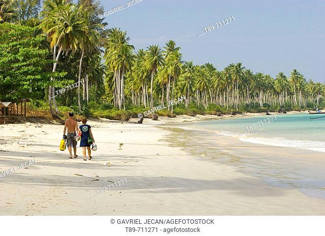 A couple walking on Khao Lak Beach, Thailand