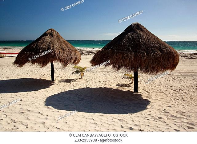 Thatched parasols at the beach, Tulum, Quintana Roo, Yucatan Province, Mexico, Central America