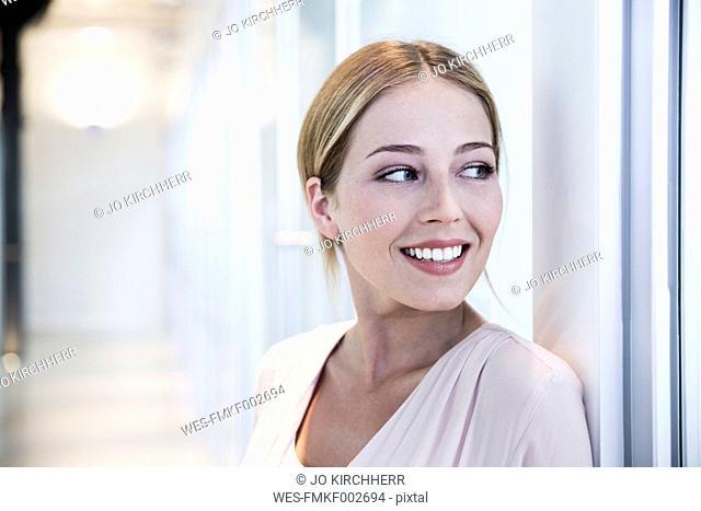 Happy woman standing in medical practice