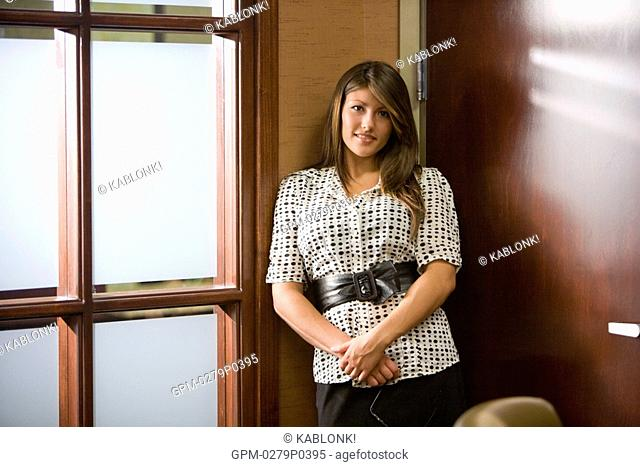 Portrait of businesswoman standing in office