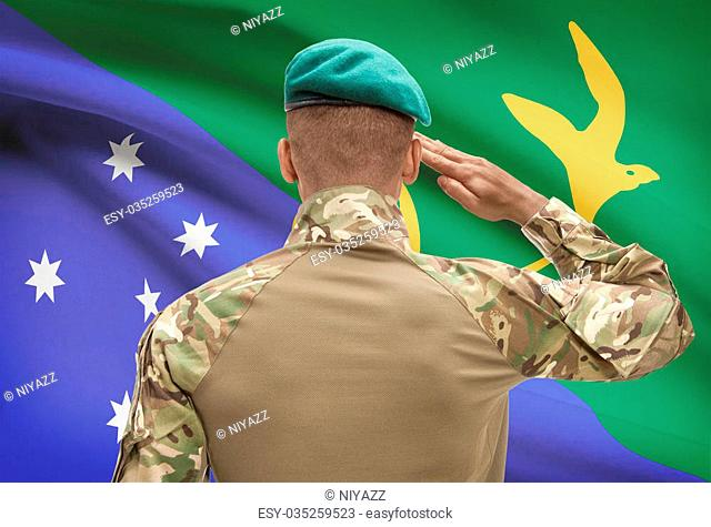 Dark-skinned soldier in hat facing national flag series - Christmas Island