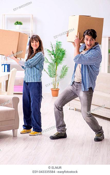 Young family moving in to new apartment after paying off mortgage