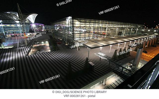 Exterior footage of Munich airport illuminated at night, Germany