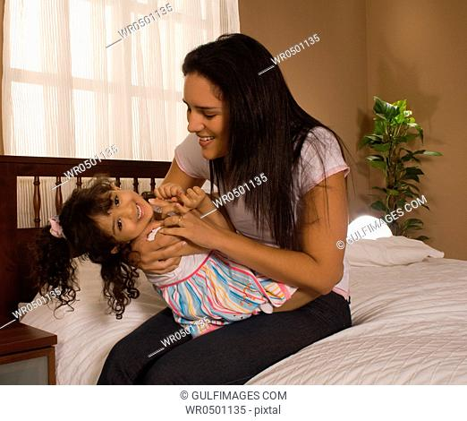 Daughter 3-4 playing with mother