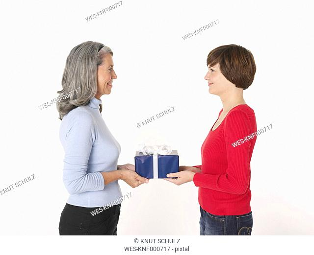 Daughter giving present to her mother