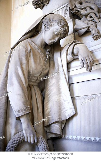 Picture and image of a mourning women stone sculpture in the realistic borgeois style. The tomb of the Stefano family Tsculpted by by G Benetti 1877