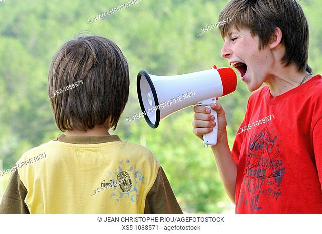 Two boys with a megaphone