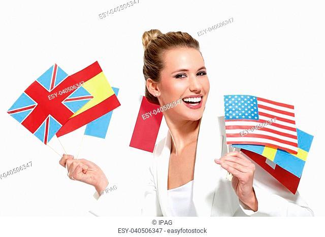 beautiful woman showing international flags on white