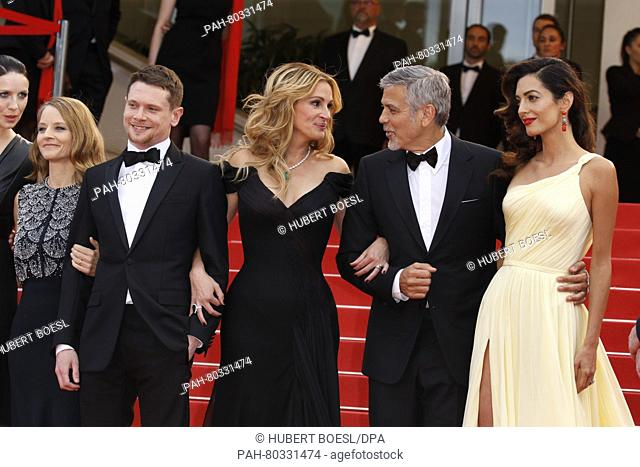 Director Jodie Foster (l-r), actors Dominic West, Julia Roberts (l-r), George Clooney and his wife Amal Clooney attend the premiere of Money Monster during the...