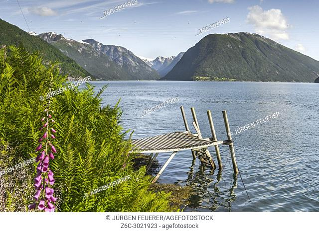 fjord panorama at the ferry station of Balestrand, Norway, Sognefjorden, old wooden landing stage and view direction to Menes and Lustrafjorden