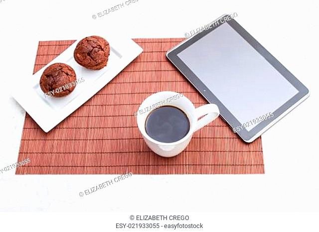 Chocolate chips Muffins with a cup of coffee and a tablet PC