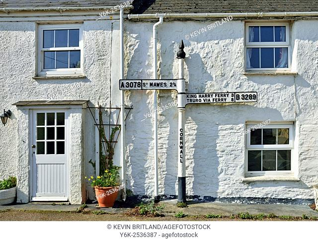 a road sign giving directions to places in cornwall, england, uk