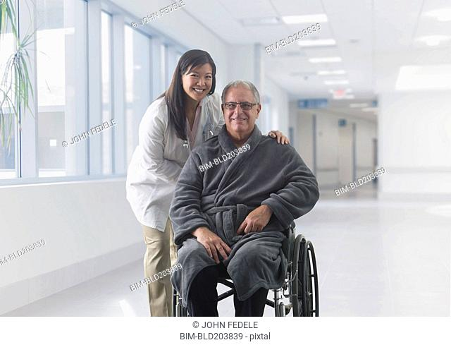 Doctor smiling with patient in hospital