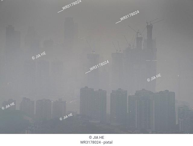 Skyline in heavy fog of the city of Chongqing under construction, Chongqing, China, Asia