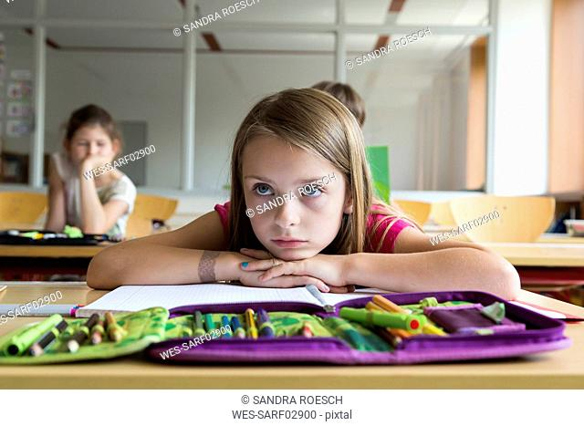 Portrait of bored schoolgirl at class