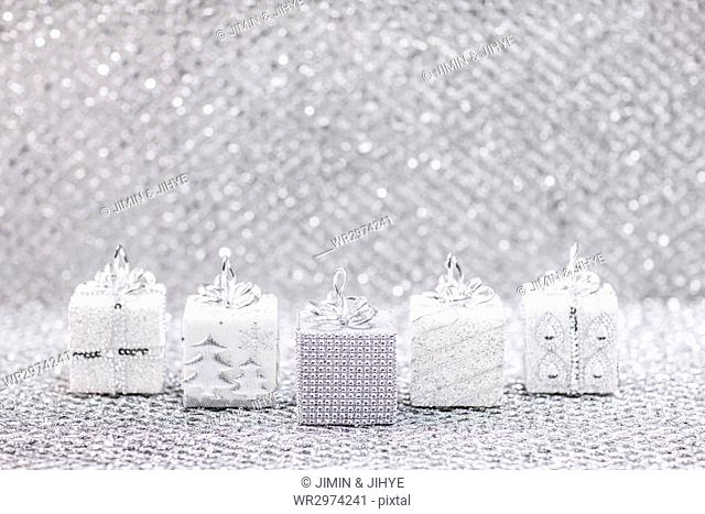 Miniatures of silver Christmas present boxes