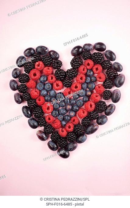 Fresh berries in heart shape, studio shot