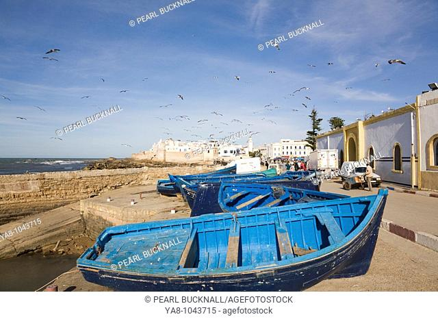 Essaouira Morocco  Small wooden fishing boats on seafront by Port Authority building  Formerly Mogador