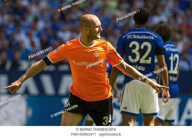Darmstadt's Konstantin Rausch celebrates his 0-1 goal during the German Bundesliga soccer match between FC Schalke 04 and Darmstadt 98 at the VeltinsArena in...