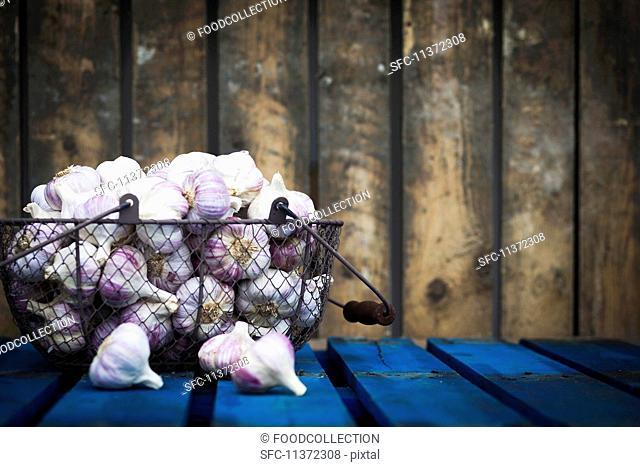 Bulbs of garlic in a wire basket