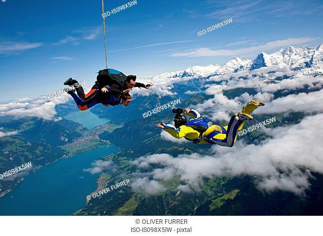 Skydivers and cameraman over Reichenbach, Bern, Switzerland