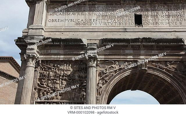 PAN. CU. Daylight. The Arch was erected in 203 AD in honor of Septimius Severus and his sons Caracalla and Geta. The spandrels of the central arch are decorated...