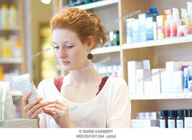 Female customer informing in an organic shop