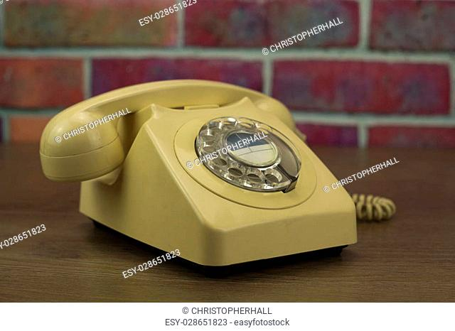 Old well used retro style rotary telephone
