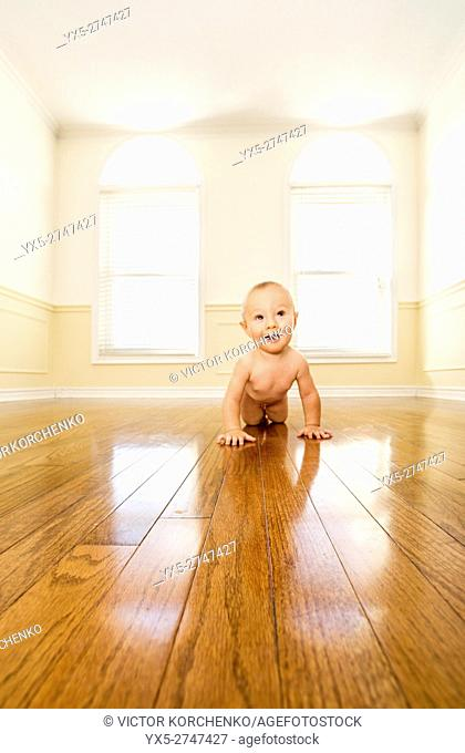 infant boy in an empty room