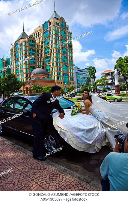 Just married in front of Notre Dame Cathedral. Ho Chi Minh City (formerly Saigon). South Vietnam