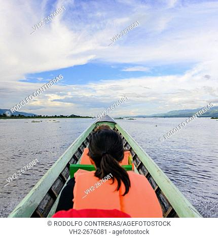Tourist in a boat in Inle Lake, Myanmar