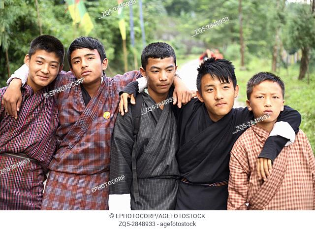 Bhutanese boys in traditional dress. Nganglam, Bhutan
