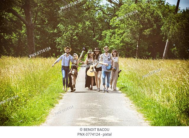 Youth group Hipster face, walking on the country road