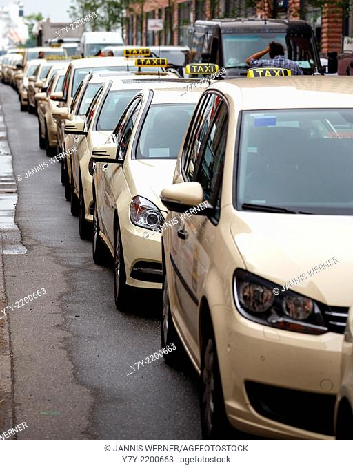 Taxis line up outside the office of German ridesharing platform WunderCar in the HafenCity of Hamburg, Germany