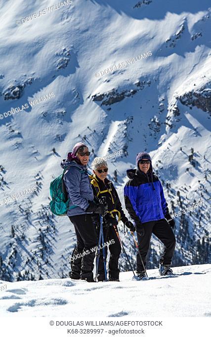 three women on Parker Ridge, Banff National Park, Alberta, Canada