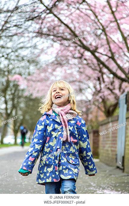 Happy little walking along pavement
