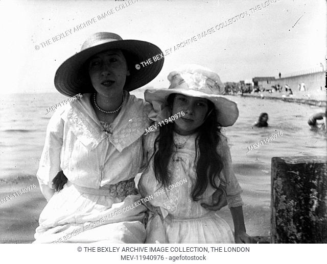 Lady and girl on beach Boswell Violet McCarthy-left, Lily Boswell-right