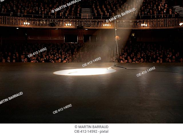 Spotlight shining on stage in theater