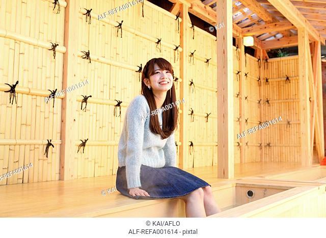 Young Japanese woman enjoying foot spa in Kawagoe, Japan
