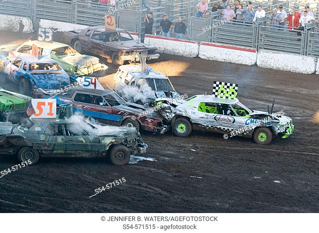 Cars crash together in a demolition derby at the state fair in Spokane, Washington, USA