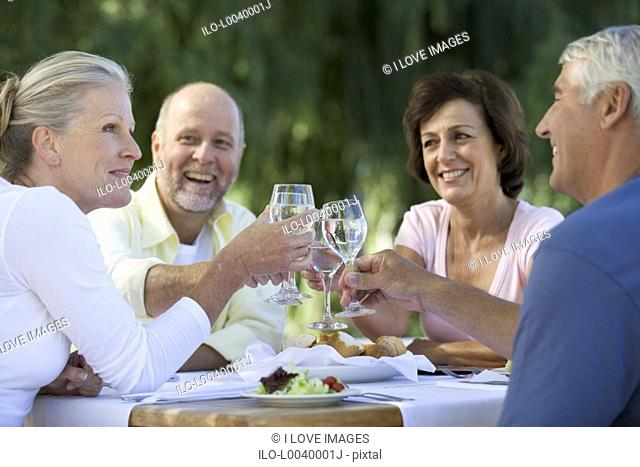 A group of senior couples at a restaurant