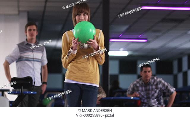 young woman and friends at a bowling alley