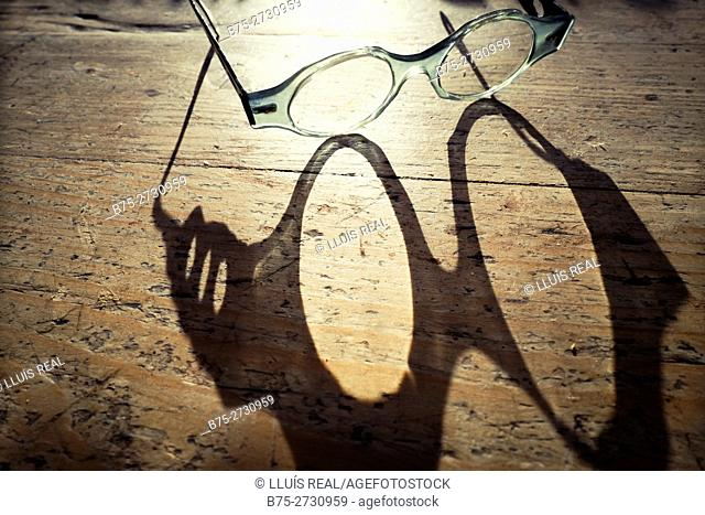 Shadow of glasses on a rustic table
