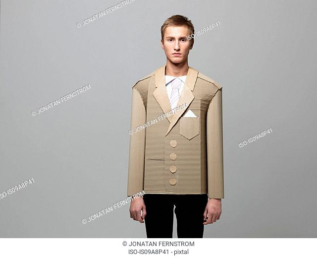 Man wearing jacket made out of corrugated cardboard