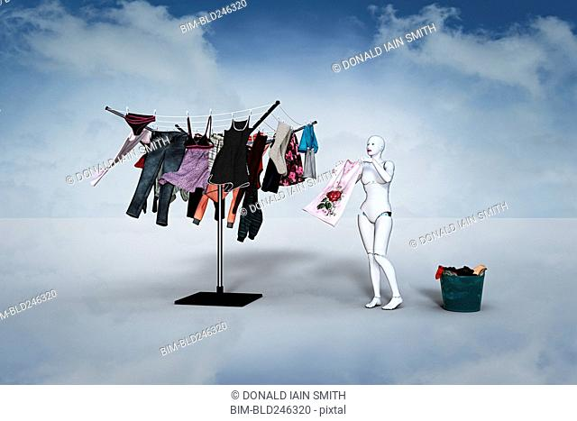Woman robot hanging laundry on clothesline