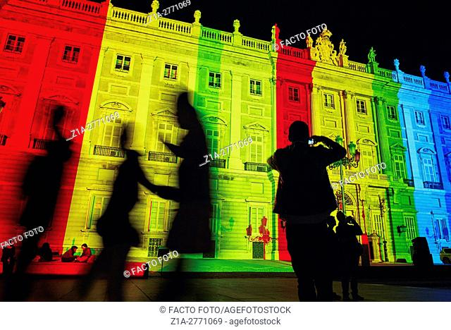 Royal Palace facade lit up with color stripes. Madrid. Spain