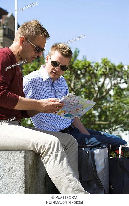 Two men with a map in Malmo Sweden