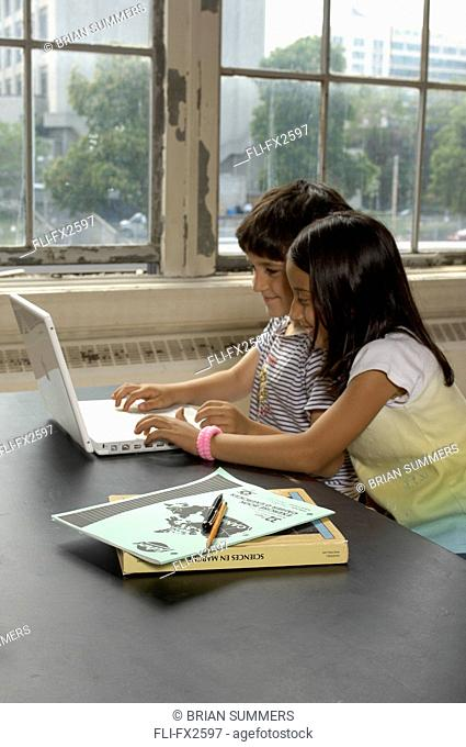 Boy and Girl on Laptop in Classroom